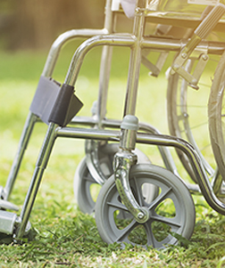Wheelchair in grass - home medical equipment from Lehan Drugs